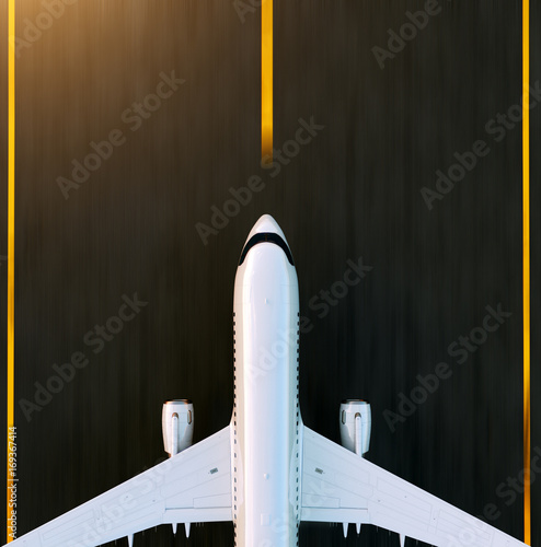 White commercial airplane taking off on the airport runway at sunset