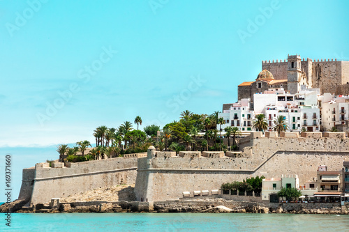 Spanish castle Peniscola, blue sea, teal blue sky