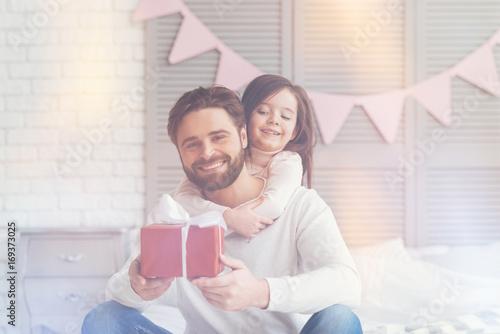 Enthusiastic vibrant family having a present ready
