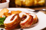 Delicious chicken rolls with dried tomatoes and mozzarella. - 169379808