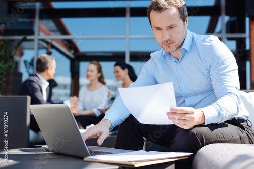 Good looking professional entrepreneur studying the document