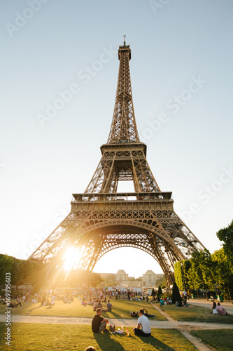 Foto op Aluminium Eiffeltoren Paris, France - June 19, 2017: View of Eiffel tower, view from Champ de Mars in the morning with a blue sky in a background