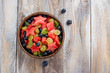 Summer fruit salad with watermelon, blueberry and grapes. Space for text