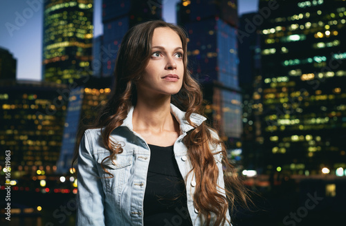Fotobehang Moskou Young beautiful girl walking in night city