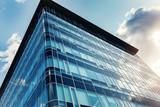 modern urban business building window wall against blue sky