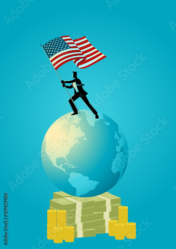 Businessman holding the flag of USA on world globe