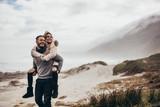 Couple enjoying winter holidays at the seashore - 169441043