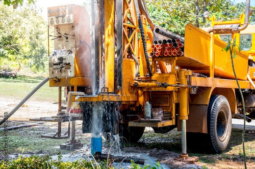Foto Murales Ground water hole drilling machine installed on the old truck in Thailand. Ground water well drilling.