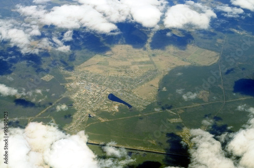 Aerial view - Clouds over western Russia at spring time - from great height.