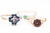 gold rings with sapphire, garnet and emerald