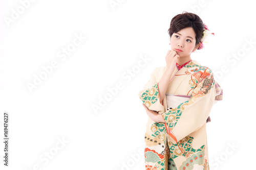 portrait of young asian woman wearing traditional kimono isolated on white background