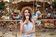 Happy pretty girl eating ice cream