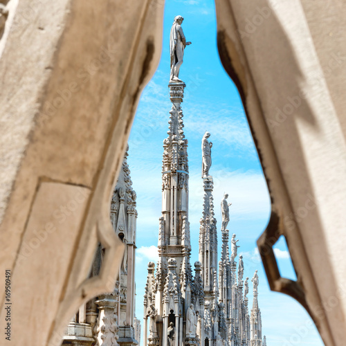 Deurstickers Milan Statues on the roof of famous Milan Cathedral Duomo