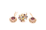 gold earrings with garnet and a ring with a mix of gems