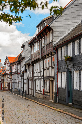 Foto op Plexiglas New York TAXI Half-timbered House in the Old town of Gorlar, Lower Saxony, Germany. Old town of Goslar is a UNESCO World Heritage
