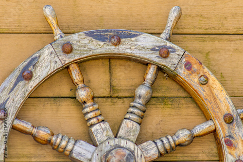 Fotobehang Schip old wooden Handwheel on wooden background