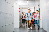 pupils running through school corridor - 169533003