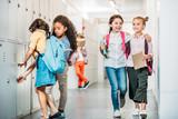 schoolgirls walking through school corridor - 169533298