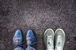 Quadro Sneakers and business shoes side by side on asphalt, work life balance concept