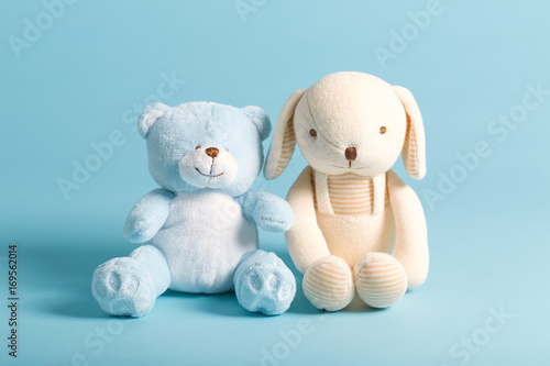 Baby's stuffed animal toys on a blue background