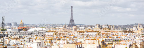 Aerial panoramic cityscape view on the beautiful buildings and Eiffel tower on the horizon during the cloudy weather in Paris - 169571862