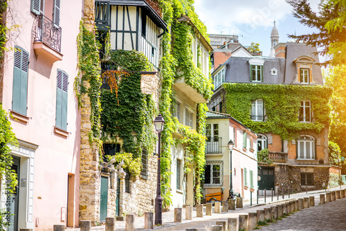 Sticker Cityscape view on the beautiful street with green buildings on Monmartre hill in Paris