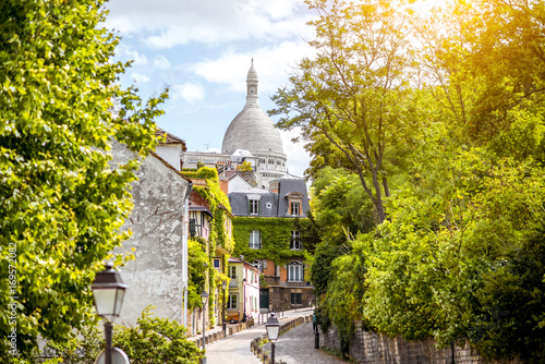 Cityscape view on the beautiful street with Sacred Heart cathedral on Monmartre hill in Paris