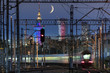 Partial moon over Warsaw city and train junction - 169576691