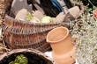 clay pot on the background of a basket with a bottle of wine background