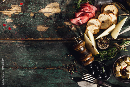 Tasty Italian Greek Mediterranean Food Ingredients Top View on Green Old Rustic Table Above - 169609024