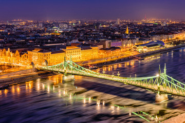 Hungarian sights. Beautiful night view of Liberty bridge over the Danube river in the historic part of Budapest, Hungary.