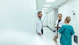 Medical team discussing in corridor at hospital
