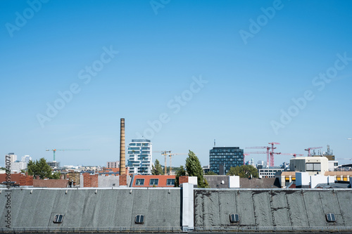rooftop view over Berlin city, roof skyline with blue sky Poster