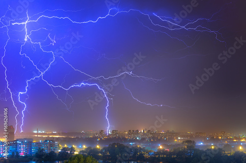 Fotobehang Kiev Lightning over the city at the summer storm. Dramatic, breathtaking atmospheric natural phenomenon.