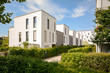 Leinwanddruck Bild - Modern townhouses in a residential area, new apartment buildings with green outdoor facilities in the city