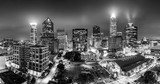 Black and white, aerial view of Charlotte, NC skyline on a foggy night. Charlotte is the largest city in the state of North Carolina and the 17th-largest city in the United States - 169635435