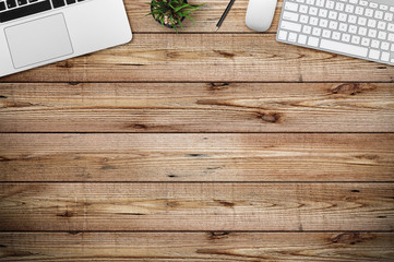 Modern workplace with notebook and smartphone copy space on wood background. Top view. Flat lay style.
