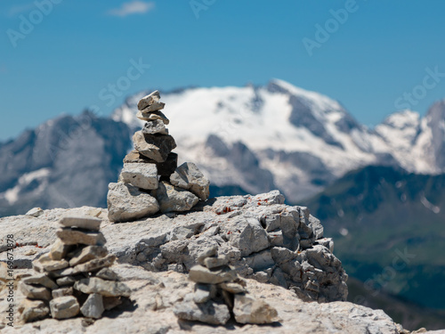 Foto op Canvas Zen Stones Piled on Each Other and Mountain Ridge in Italian Dolomites Alps in Summer Time in Background
