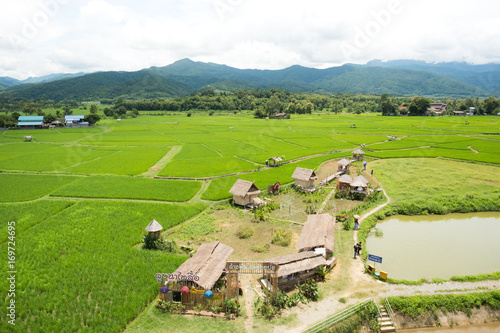 Fotobehang Rijstvelden Countryside with rice field, nice blue sky and small vintage of Nan, Thailand.
