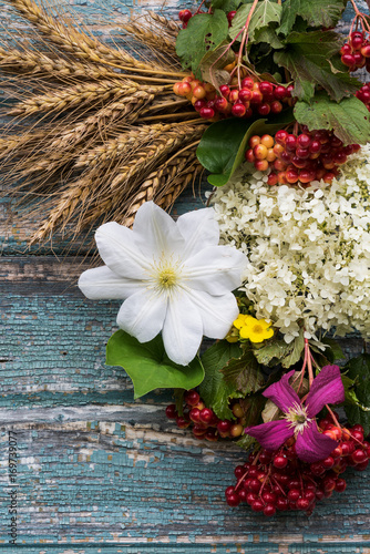 Fotobehang Hydrangea The flowers of Clematis, Hydrangeas ears of wheat on wooden background.