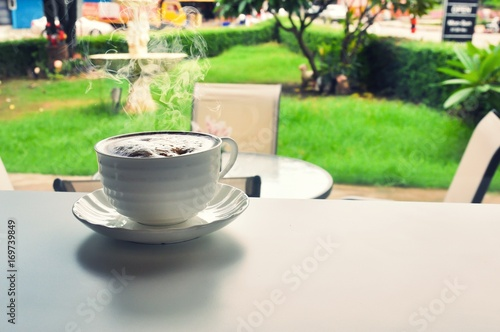 Fotobehang Thee warm cup of coffee in cofee shop