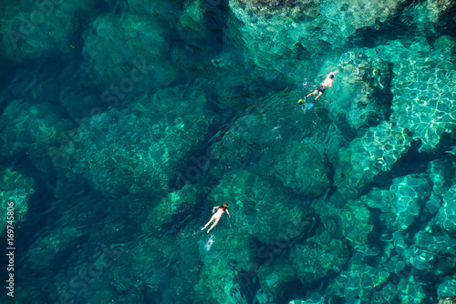 Fotobehang Zanzibar Drone picture of a couple snorkeling in the sea