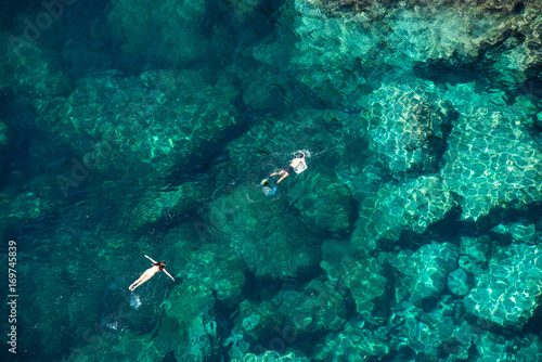 Deurstickers Zanzibar Couple snorkeling in the sea
