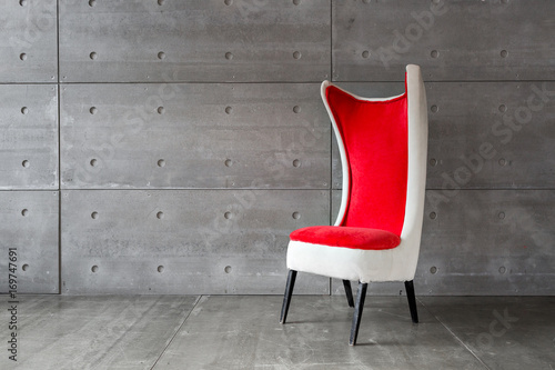 modern red chair and concrete wall. copy space