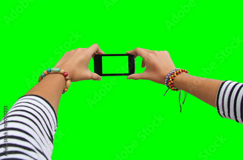 Young girl hand holding mobile smart phone on green screen - 169750203