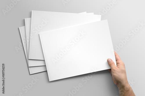 Fotobehang Donkergrijs Blank A4 photorealistic landscape brochure mockup on light grey background.