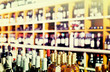 View on supermarket shelves with wine bottles