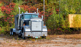 Powerful truck surrounded by foliage trees, New England