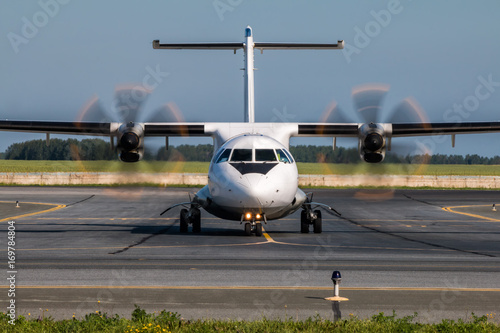 Taxiing turboprop airplane from the runway