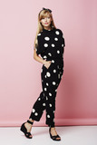 Beautiful woman in spotted jumpsuit, posing - 169787680